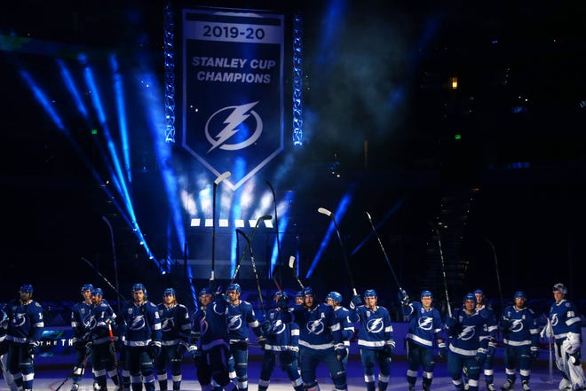 The Tampa Bay Lightning reveal their Stanley Cup banner before the home opener.