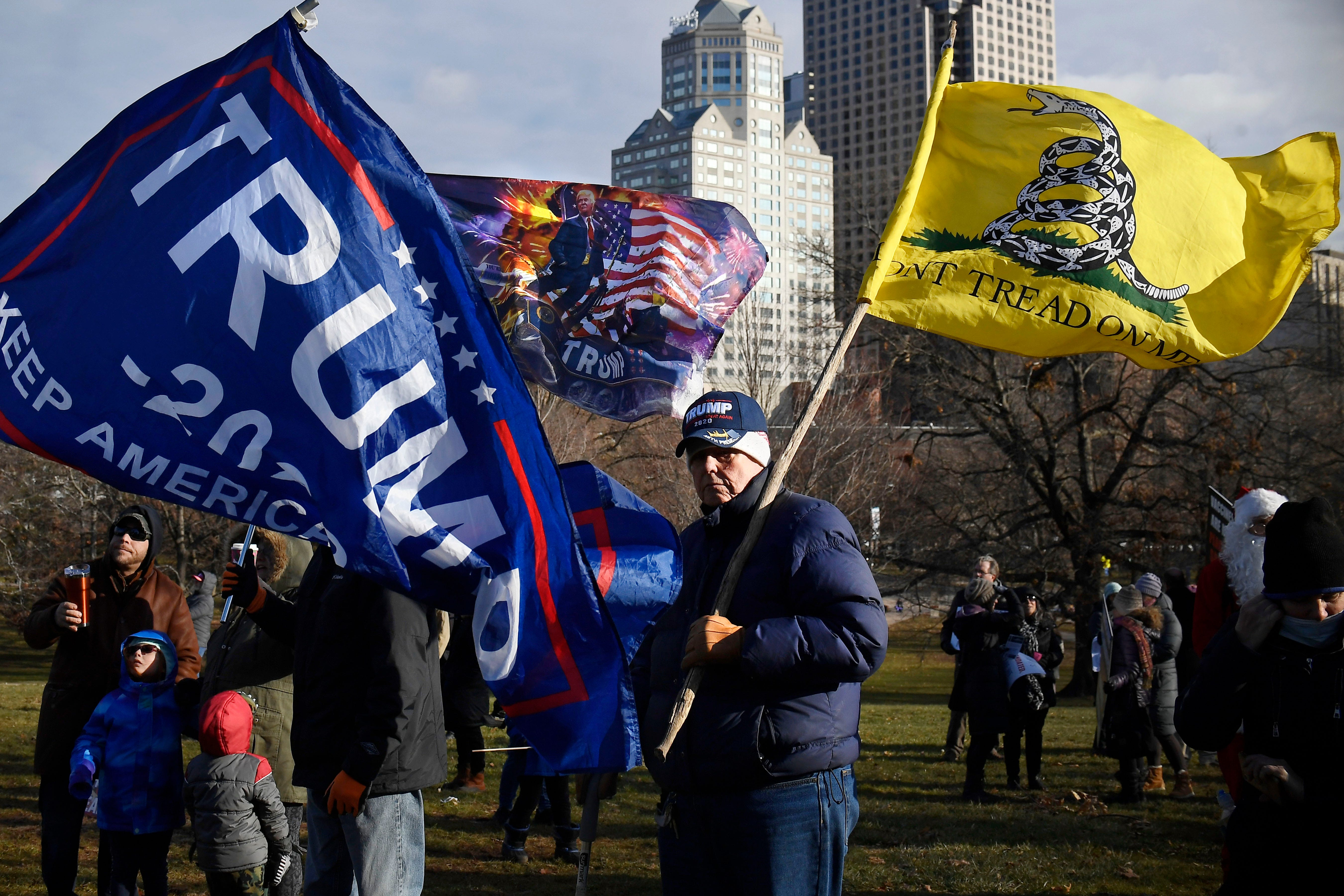 A Trump supporter protests outside on the State Capitol grounds, Wednesday, Jan. 6, 2021, in Hartford, Conn. Hundreds of protesters turned out for the swearing-in ceremonies.