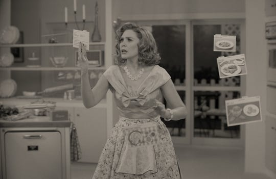 "Wanda Maximoff (Elizabeth Olsen) conjures up a dinner on the fly in the 1950s-set first episode of Disney+'s ""WandaVision."""