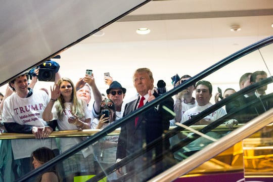 Donald Trump rides an escalator to a press event to announce his candidacy for the U.S. presidency at Trump Tower on June 16, 2015 in New York City.