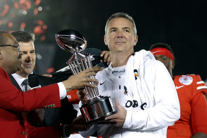 Urban Meyer as Ohio State coach holds the trophy after the team's 28-23 win over Washington in the Rose Bowl after the 2018 season.