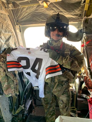 U.S. Army Cpl. Nate Hensal poses with his Nick Chubb jersey on Monday morning after the Browns defeated the Steelers in Sunday's playoff game.