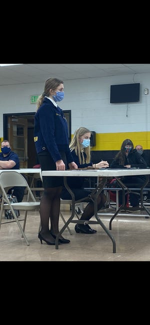 Acting as president and secretary for the mock parliamentary procedure competition at a recent Black River school board meeting are Chloee Howard (right) and Abigail Groesser. Christine Jenkinson photo, Times-Gazette