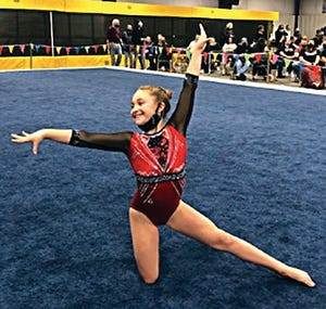 Bartlesville Gymnastics Club standout Kinlee Littleford displays her style on the floor exercise.