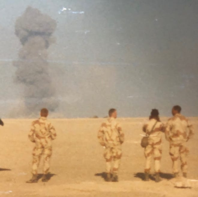 Mike Bean's fellow soldiers watch from a safe distance as the Mother of all Bombs -- M.O.A.B. -- strikes the Hammurabi division of the Republican Guard in Iraq.