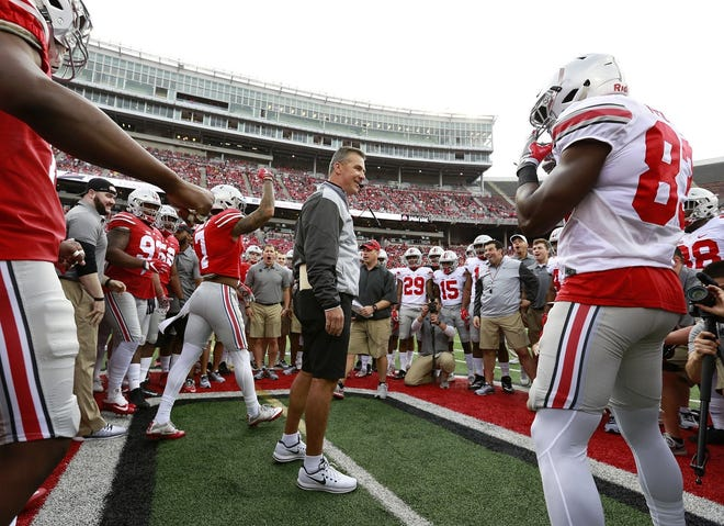 """Urban Meyer, here preparing to oversee a """"circle drill"""" in the 2017 Ohio State spring game, said he has a good feel for how his job will change coaching professionals instead of college players."""