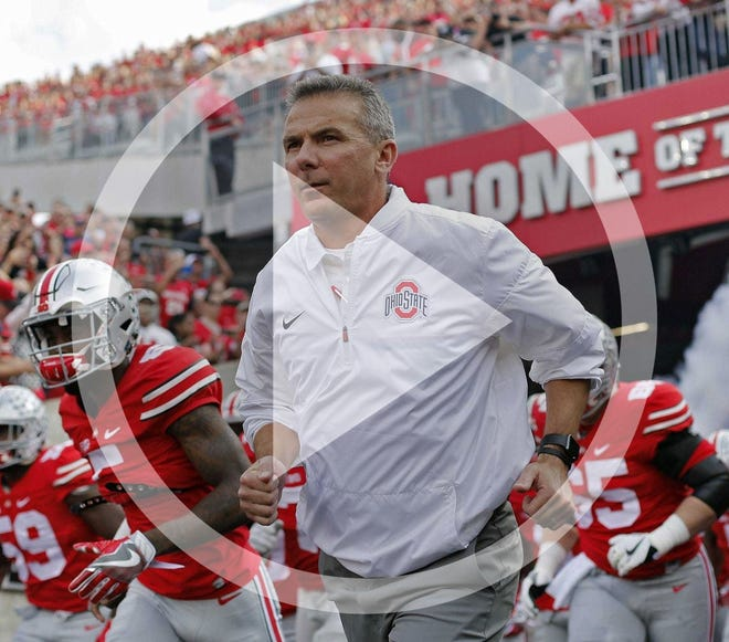In this file photo, Urban Meyer, here leading Ohio State on the field in a 2016 game, coached the Buckeyes to an 83-9 record in seven seasons.