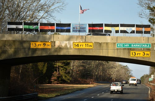 The flags on the First Responders Bridge on Route 149 in West Barnstable were damaged overnight by vandals who threw acid on them, according to police. The incident marks the fifth time the flags have been vandalized or stolen since being placed on the overpass in 2018,.  [Steve Heaslip photos/Cape Cod Times]