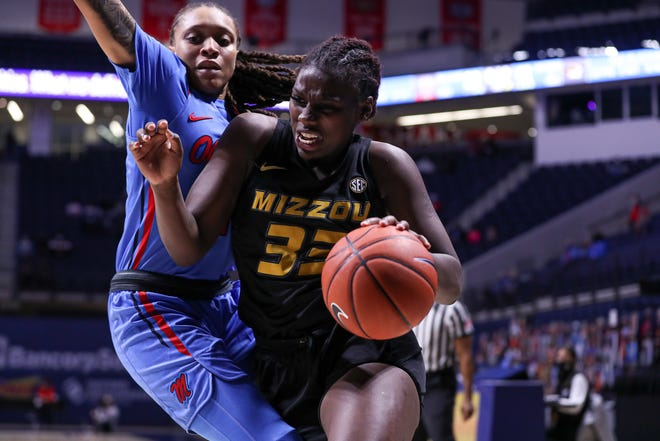 Missouri guard Aijha Blackwell (33) drives the ball during a game against Mississippi on Thursday night at The Pavilion in Oxford, Miss.