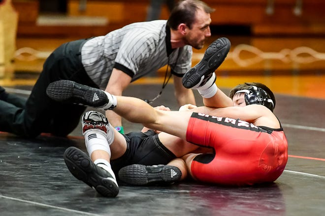 Freshman Lane McCoy of the Chillicothe High School wrestling Hornets completes his 54-seconds win by fall over Luke Johnson of Gallatin in the 106-pounds division Thursday. The victory in the final bout of the dual match lifted the Hornets to a 42-39 victory. McCoy also won his bout against a Brookfield opponent by first-period fall as CHS improved its record to 14-7 with the sweep of its 2020-21 home opener.