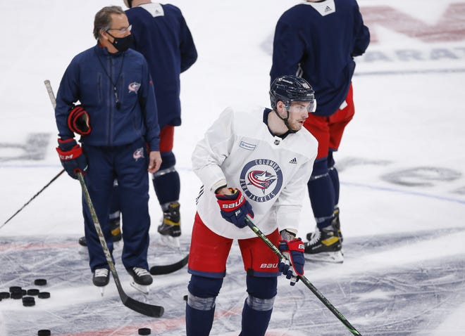 Blue Jackets coach John Tortorella, left, wants center Pierre-Luc Dubois, right, to speak out about why he wants out of Columbus.