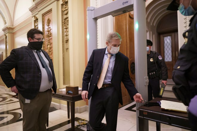 Rep. Jim Jordan, R-Urbana, prepares to pass through a metal detector as he enters the House chamber, part of new security measures put into place after a mob loyal to Donald Trump stormed the Capitol this month. Jordan says the detectors violate the Second Amendment.