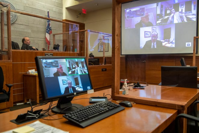 Judge Michael J. Holbrook holds a court hearing remotely using Zoom video conferencing in a Franklin County Common Pleas courtroom on Jan. 15, taking advantage of technology that has helped courts across the state resolve cases amid the COVID-19 pandemic.
