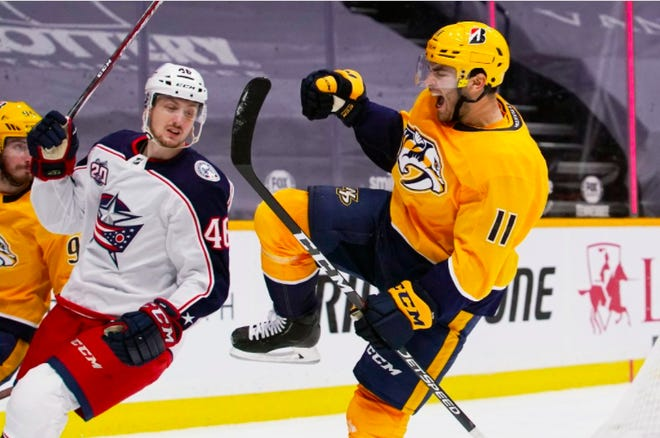 Predators center Luke Kunin celebrates after scoring a goal against the Blue Jackets in the second period of the season opener for both teams Thursday night in Nashville.