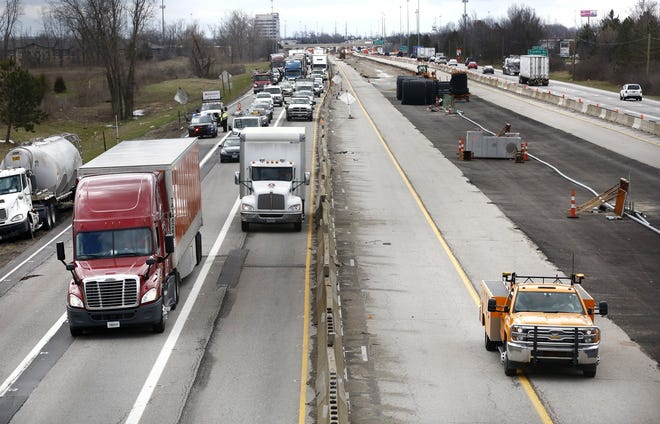 "Traffic heads north on I-270 on the west side, as seen from Davidson Road bridge, during construction in April 2018. The Ohio Department of Transportation is recommending the state ""pause"" applications for major new construction funding because gas-tax revenue hasn't met expectations during the COVID-19 pandemic. [Fred Squillante/Dispatch]"