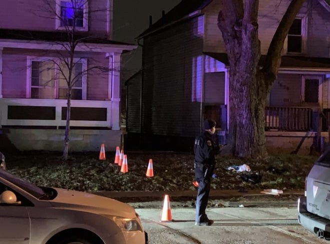 Columbus police secure the scene of a homicide Thursday night, outside a home in the 1000 block of Leona Avenue in the Milo-Grogan neighborhood of the Near East Side. It was the second homicide on that street in just three days and the 13th in the city in the first 14 days of 2021.