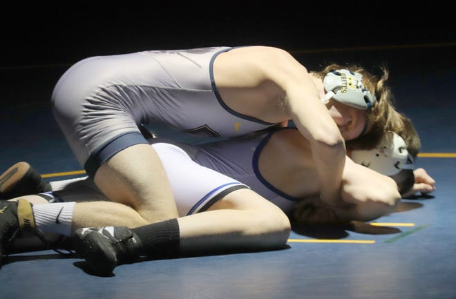 Zach Brown won his first match of the season by pinning Hillsboro's Carter Iverson Thursday evening. Crookston beat Roseau and fell to Hillsboro/Central Valley in its season-opening triangular meet.