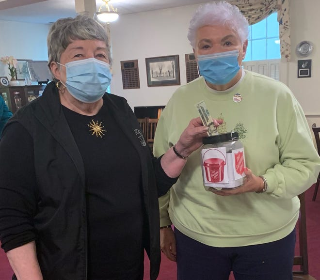 Shown supporting the Salvation Army's Red Kettle Campaign are, from left, Dover Century Club President Jane DiMondi and project chairman Elaine Crowell.