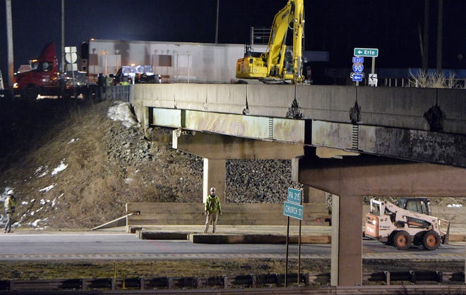 Demolition began on Wednesday of the damaged bridge that carries Route 215 over Interstate 90 in Springfield Township.