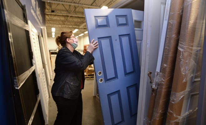 Nancy Milkowski, Greater Erie Area Habitat for Humanity's executive director, shows some of the doors for sale at Greater Erie Habitat for Humanity's ReStore.
