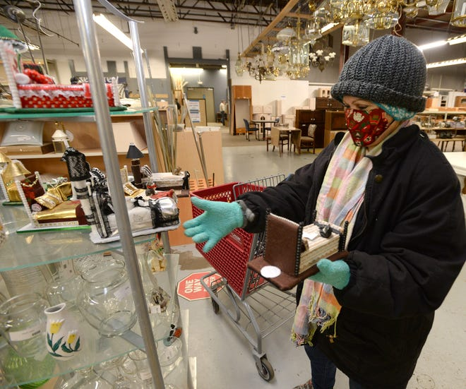 Irma Ruiz of Erie shops at the Greater Erie Habitat for Humanity's ReStore.