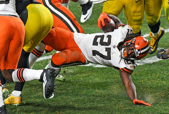 Cleveland Browns running back Kareem Hunt (27) reaches for extra yardage in last Sunday's playoff win over Pittsburgh. The former Chief returns to Kansas City Sunday with the Browns for the AFC Divisional playoff.