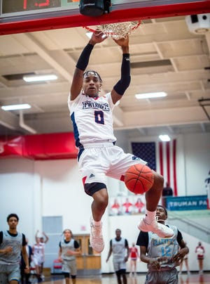 Truman guard Najee Williams slams the ball in the hoop in Thursday's game at Truman. Williams had five dunks and scored 26 points but the Patriots lost 76-62.