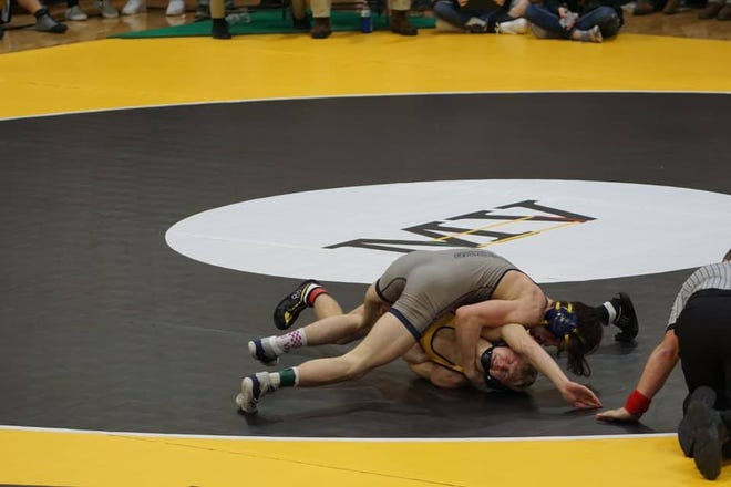 Notre Dame-West Burlington/Danville junior Blaine Frazier (top) pinned  his three opponents Thursday night at New London.