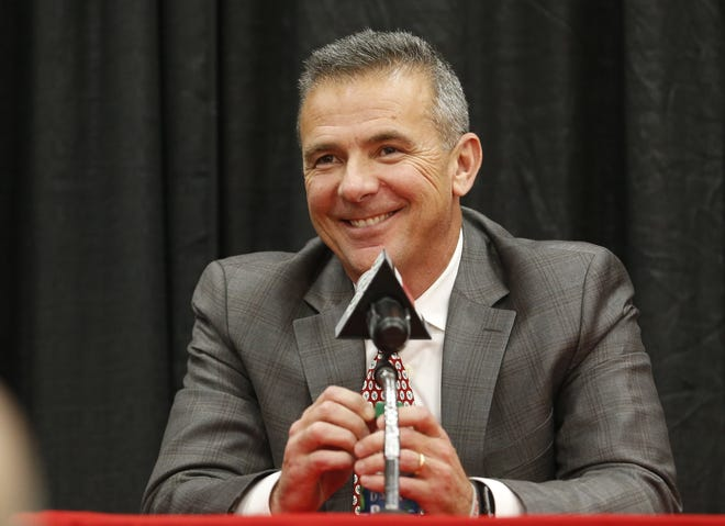 """Jaguars' coach Urban Meyer, seen here at his retirement announcement as Ohio State coach in 2018, did a commendable job from a public relations standpoint Friday in his introductory press conference. He won over the Jaguars' fan base, saying they """"deserve a winner."""""""
