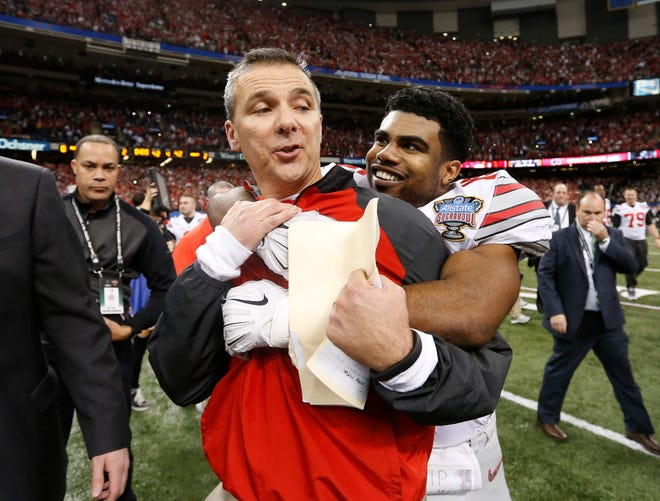 Ohio State Buckeyes head coach Urban Meyer is hugged by running back Ezekiel Elliott (15) after the 2015 Sugar Bowl against the Alabama Crimson Tide at Mercedes-Benz Superdome on January 1, 2015 in New Orleans. Ohio State defeated Alabama 42-35. Mandatory Credit:  Matthew Emmons-USA TODAY Sports