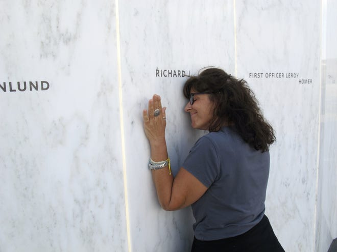 Lori Guadagno of Jacksonville Beach touches her brother's name on the Wall of Names during a 2012 visit to the Flight 93 National Memorial near Shanksville, Pa. Richard Guadagno was one of the passengers aboard United 93 on Sept. 11, 2001.
