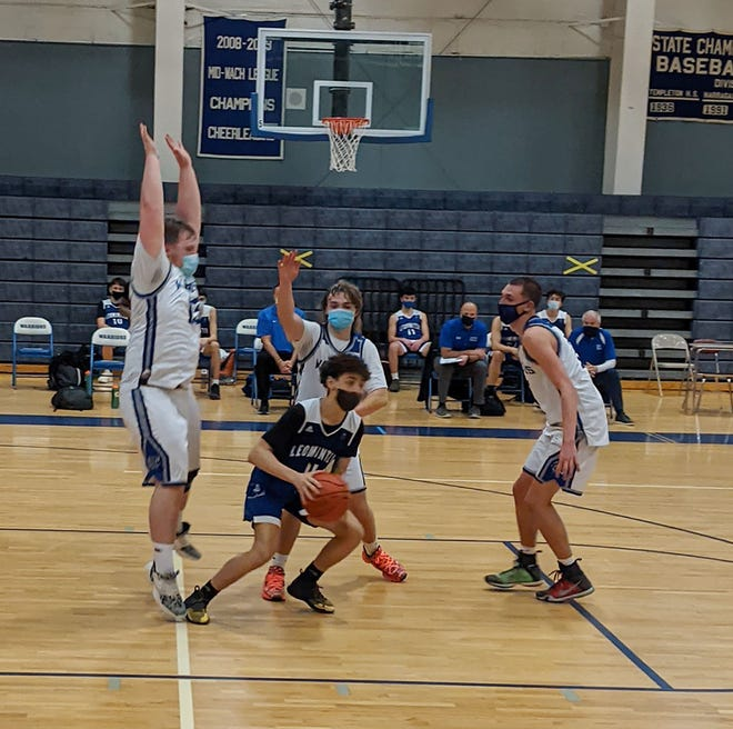 Narragansett's Anthony Stowell (left) cuts off Leominster guard Kevin Viola's path to the basket during the Warriors' loss to the visiting Blue Devils, Thursday evening, at Elinor J. Putnam Gymnasium in Baldwinville.