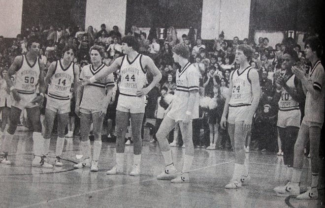 Monmouth High School's senior basketball players were honored prior to their final home game on Feb. 12, 1982, which turned out to be a record-setter – a 118-45 victory over Aledo. Pictured from left are Jerome Birditt, Mel Blasi, Mike Murphy, Mike Miller, John Kinney, Mark McCurdy, Fred Hayes and Tony Deford. The Zippers set program records for points in a quarter (37), half (62) and game.
