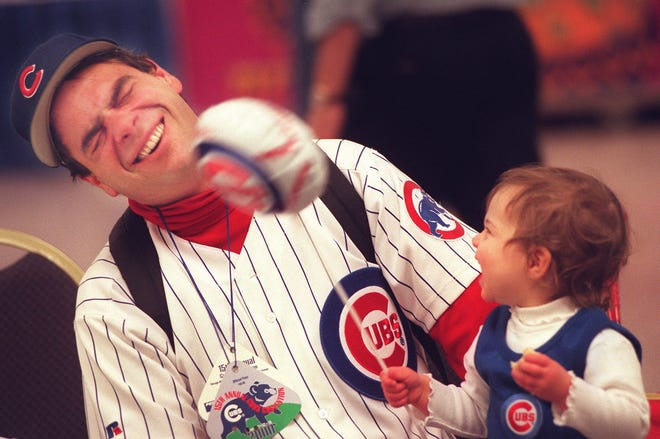 Mark Nieds with his one-year-old daughter Lucy at the 2000 Cubs Convention.
