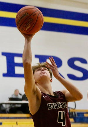 Buhler's Hayden Keller (4) shoots against Nickerson on Thursday evening during a make-up game. Buhler defeated Nickerson 69-38.