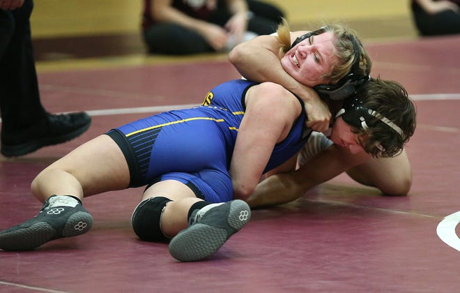 Buhler's Martean Perez wrestles Circle's Katelyn Schmidt in the 145-pound weight class during Buhler's home opener Tuesday. Perez won by fall. Buhler defeated Circle 60-24.