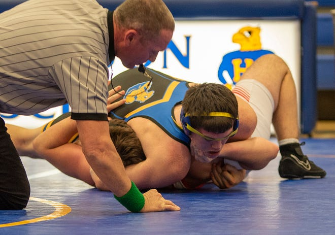 Hutchinson High's Jayden Crubbs pins Maize's Peyton Peterman in the 195-pound weight class in the North Gym at HHS on Thursday. The Salthawks fell 65-6.