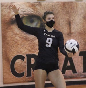 Croatan's Devon Statham prepares to serve the ball during a match earlier this season. [Chris Miller / The Daily News]