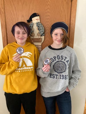 Junior members of the Lena American Legion Auxiliary recently earned the Centennial patch from the National office.  Pictured: Riley Durling and Evie Karnatz