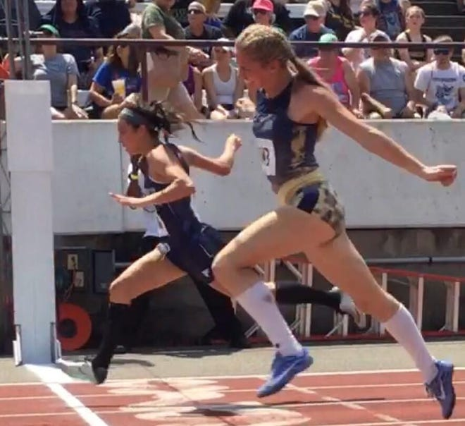 Frankfort grad Kayla Grose is shown in action two track seasons ago at the state meet.  Spring sports practice may begin March 15.