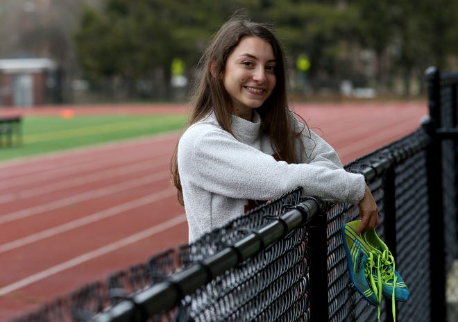 """Joanna """"Jojo"""" Kennedy, 20, was at the Wellesley High School track, Jan. 15, 2021. She is a 2018 graduate of WHS and a junior at MIT where she is a long jumper on the track team."""