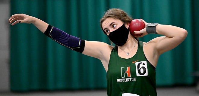 Hopkinton High junior Kate Powers prepares to throw the shot put  during a meet against Dover-Sherborn at Wheaton College in Norton, Jan. 14, 2021. Powers set a new school record in discus on Tuesday.