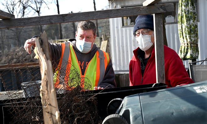 Attendant Tom Harmon, left,  directs Fred Elliott of Milford to where he can recycle metal at the Milford Transfer Recycle Station, Jan. 15, 2021.