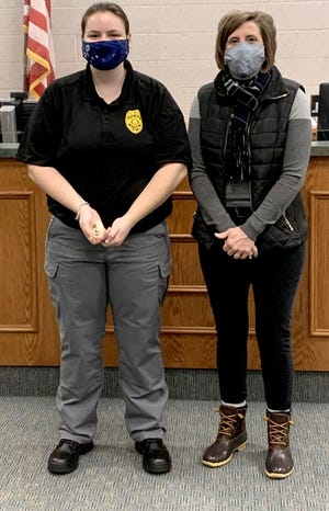 Audrey Hook, left, became the first Ottawa High School student to graduate from the Police Cadet Program and be hired by the Ottawa Police Department.