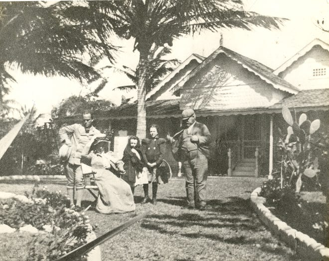Sidney Maddock, at left and Henry Maddock, right, circa 1897. Visiting English cousins sit between the two. HISTORICAL SOCIETY OF PALM BEACH COUNTY