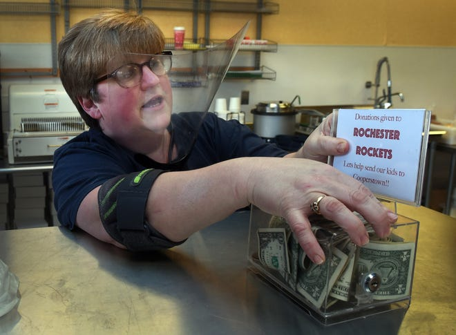 Potter's House Bakery owner Sue Wilson and her husband Tim have put a donation container on their counter to help the Rochester Rockets team members to raise money so the kids can go to Cooperstown.