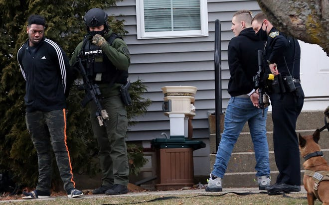 Christopher A. McLaughlin, right, 22, of Newton, Massachusetts, and Ande Keele, 22, of Brockton, Massachusetts, are taken into custody at Whittier Falls housing Friday, Jan. 15, 2021 as Dover police, State Police and the Strafford County Regional Tactical Operations Unit assisted.
