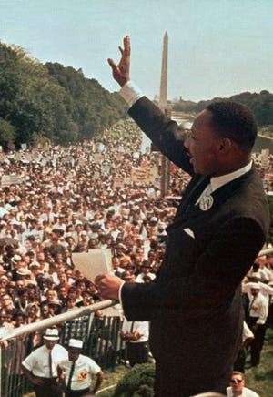 """Dr. Martin Luther King Jr. acknowledges the crowd at the Lincoln Memorial for his """"I Have a Dream"""" speech during the March on Washington, D.C. on Aug. 28, 1963."""