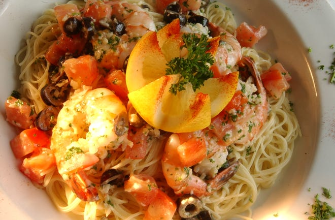 Lightly sauteed shrimp is served over angel hair pasta with a delicate butter and white wine sauce for this Shrimp Scampi.