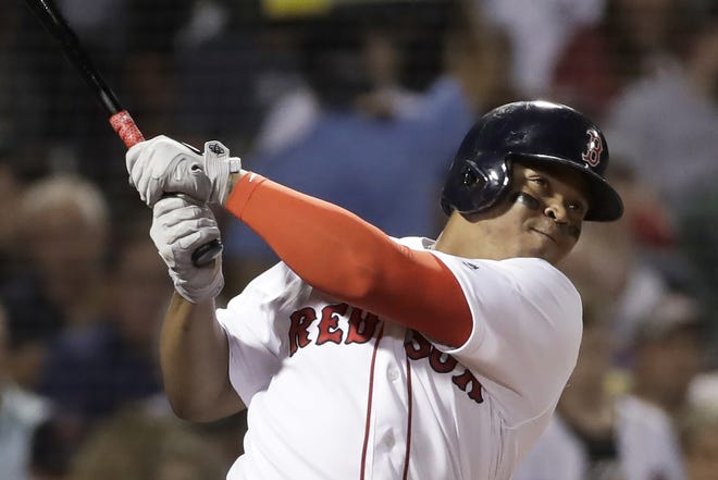 Boston Red Sox slugger Rafael Devers hits a three-run homer against the Minnesota Twins during a game at Fenway Park on Sept. 3, 2019. On Friday, Devers agreed to one-year deal with the Red Sox.